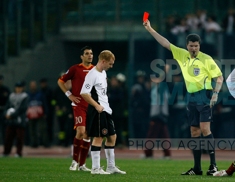 Manchester United's Paul Scholes (C) is shown the red card by referee Herbert Fandel for a second yellow card offence, a tackle on Roma's Francesco Totti.