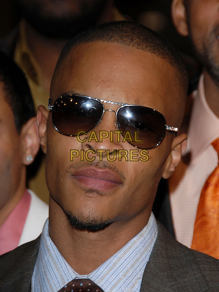 "TIP HARRIS - T.I..L.A. Premiere of ""ATL"" held at The Grauman's Chinese Theatre in Hollywood,California on .March 30th, 2006.Ref: DVS.headshot portrait goatee facial hair sunglasses shades.www.capitalpictures.com.sales@capitalpictures.com.Supplied By Capital PIctures"