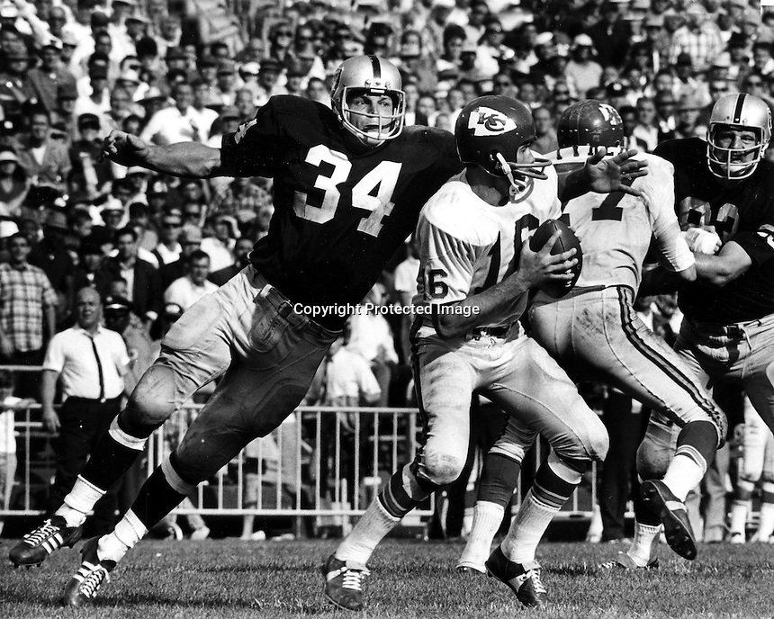 Oakland Raiders linebacker Gus Otto about to sack Kansas City quarterback Len Dawson. (photo by Ron Riesterer)