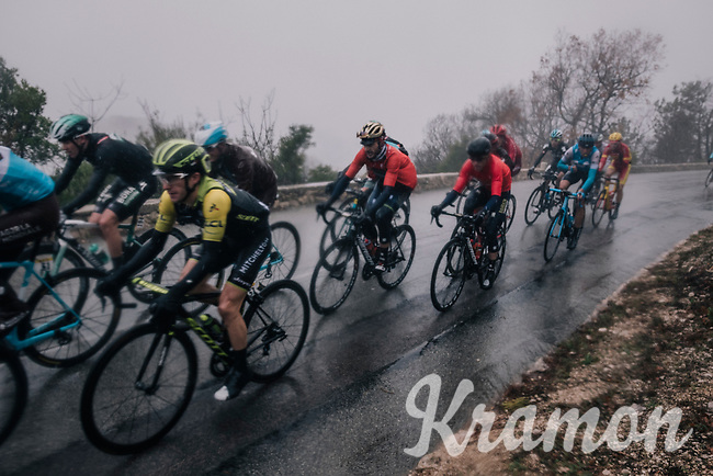 Blurry pic of (hidden under a rain-jacket) yellow jersey / GC leader Simon Yates (GBR/Michelton-Scott) trying to defend his standing in the rain<br /> <br /> 76th Paris-Nice 2018<br /> Stage 8: Nice > Nice (110km)