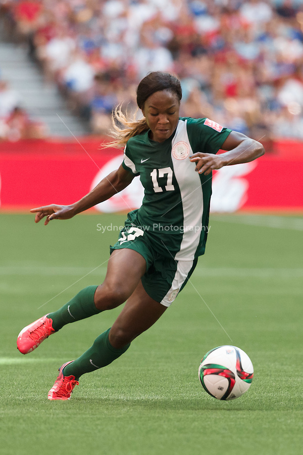 June 16, 2015: Francisca ORDEGA of Nigeria controls the ball during a Group D match at the FIFA Women's World Cup Canada 2015 between Nigeria and the USA at BC Place Stadium on 16 June 2015 in Vancouver, Canada. USA won 1-0. Sydney Low/Asteriskimages.com