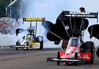 Aug 16, 2014; Brainerd, MN, USA; NHRA top fuel driver Richie Crampton (left) alongside Spencer Massey during qualifying for the Lucas Oil Nationals at Brainerd International Raceway. Mandatory Credit: Mark J. Rebilas-USA TODAY Sports