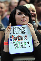 Pictured: A fan with a 'Nicky Fucking Wire' placard in the crowd Saturday May 2016<br /> Re: Manic Street Preachers at the Liberty Stadium, Swansea, Wales, UK