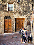 The kiss, tourists in the streets of San Gimignano, Siena-Tuscano, Italy
