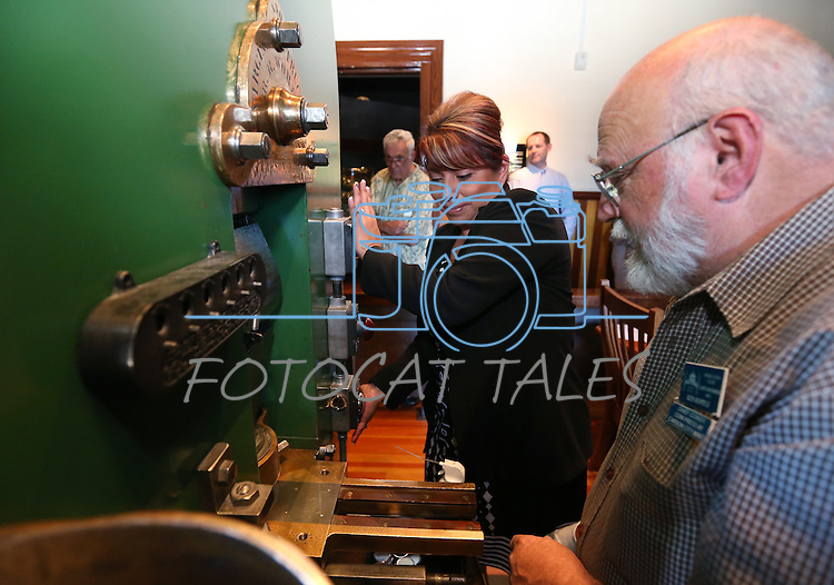 Coiner Ken Hopple watches Sherry Rupert mint a medallion of the fourth and final in a commemorative Sesquicentennial series at the Nevada State Museum, in Carson City, Nev., on Wednesday, Sept. 3, 2014. <br /> Photo by Cathleen Allison