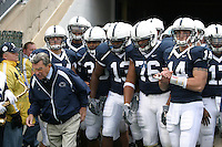 State College, PA - 10/21/2006 - Penn State offensive linemen Gerald Cadogan (76) stands with coach Joe Paterno, quarterback Anthony Morelli (14), and his other teammates before running out of the tunnel to start the game against the University of Illinois on October 21, 2006, at Beaver Stadium.  The Nittany Lions defeated the Illini 26-12...Photo credit: Joe Rokita / JoeRokita.com