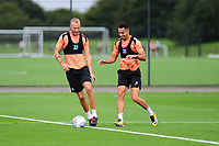 Mike van der Hoorn battles with Courtney Baker-Richardson of Swansea City during the Swansea City Training Session at The Fairwood Training Ground, Wales, UK. Tuesday 11th September 2018