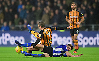 Hull City's Evandro Goebel is tackled by Sheffield Wednesday's Sam Hutchinson<br /> <br /> Photographer Chris Vaughan/CameraSport<br /> <br /> The EFL Sky Bet Championship - Hull City v Sheffield Wednesday - Saturday 12th January 2019 - KCOM Stadium - Hull<br /> <br /> World Copyright &copy; 2019 CameraSport. All rights reserved. 43 Linden Ave. Countesthorpe. Leicester. England. LE8 5PG - Tel: +44 (0) 116 277 4147 - admin@camerasport.com - www.camerasport.com
