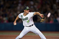 Hillsboro Hops relief pitcher Travis Moths (10) delivers a pitch during a Northwest League game against the Salem-Keizer Volcanoes at Ron Tonkin Field on September 1, 2018 in Hillsboro, Oregon. The Salem-Keizer Volcanoes defeated the Hillsboro Hops by a score of 3-1. (Zachary Lucy/Four Seam Images)
