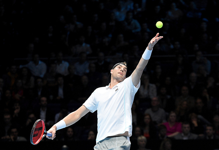 John Isner  in action against Novak Djokovic <br /> <br /> Photographer Hannah Fountain/CameraSport<br /> <br /> International Tennis - Nitto ATP World Tour Finals Day 2 - O2 Arena - London - Monday 12th November 2018<br /> <br /> World Copyright © 2018 CameraSport. All rights reserved. 43 Linden Ave. Countesthorpe. Leicester. England. LE8 5PG - Tel: +44 (0) 116 277 4147 - admin@camerasport.com - www.camerasport.com