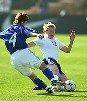 Cindy Parlow slides for the ball against Yasuyo Yamagishi during a 0-0 tie in San Diego, Calif.,  January 12, 2003.