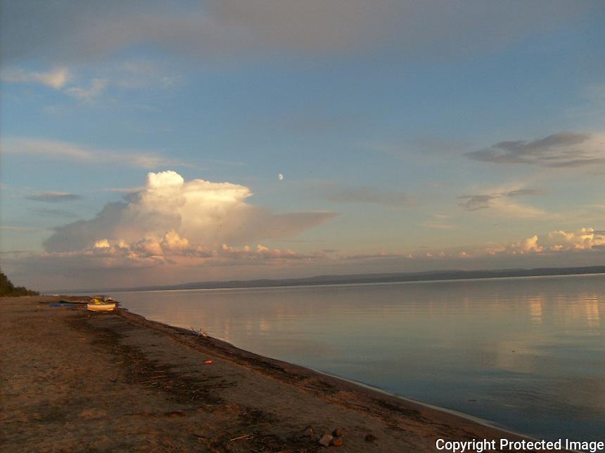 Sunset cumulonimbus cloud over Slave Lake Alberta.