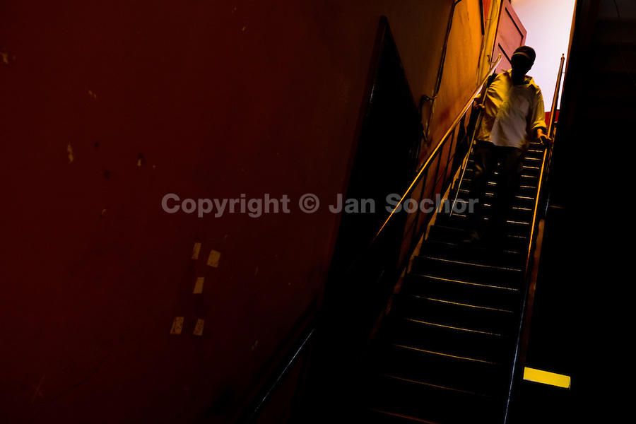 A blind man, using a white cane, walks down the stairs in the corridor of Unión Nacional de Ciegos del Perú, a social club for the visually impaired in Lima, Peru, 5 April 2013. Unión Nacional de Ciegos del Perú, one of the first societies for disabled in Latin America, was established in 1931 to provide a daily service for blind and partially sighted people from the capital city. The range of activities includes reading books in a large Braille library, playing chess or using a computer adapted for visually impaired individuals. As the majority of the blind does not have a regular job, the UNCP club offers them an opportunity to learn and lately, to provide massages to the club visitors and thus generate some income.