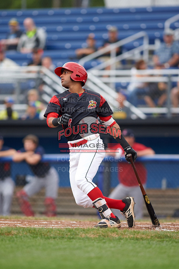 Batavia Muckdogs third baseman J.C. Millan (4) hits a two run triple in the bottom of the first inning during a game against the Lowell Spinners on July 12, 2017 at Dwyer Stadium in Batavia, New York.  Batavia defeated Lowell 7-2.  (Mike Janes/Four Seam Images)