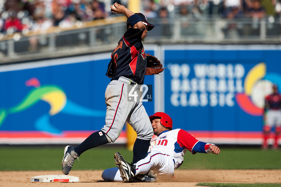 15 March 2009: #8 Akinori Iwamura of Japan throws the ball as #10 Yulieski Gourriel of Cuba slides to second base during the 2009 World Baseball Classic Pool 1 game 1 at Petco Park in San Diego, California, USA. Japan wins 6-0 over Cuba.