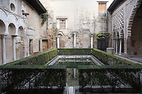 Low angle view of Patio del Yeso (Plaster Courtyard), Real Alcazar, Seville, Spain, pictured on December 26, 2006, in the afternoon. This courtyard dates back to the 12th century. The Real Alacazar was commissioned by Pedro I of Castile in 1364 to be built in the Mudejar style by Moorish craftsmen. The palace, built on the site of an earlier Moorish palace, is a stunning example of the style and a UNESCO World Heritage site. This Patio, with traditional Moorish garden and pool,  is part of the original ancient Almohad palace. Picture by Manuel Cohen.