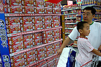 Nestle wafer chocolates are on sale with a promotion in a Carrefour supermarket in Beijing, China. Major international chains like Carrefour and Walmart Stores have expanded aggressively in China. Local Chinese retailers have loudly protested this and lobbied heavily for protection from the new competition in price and service that these major retailers have set off..22 Jul 2006
