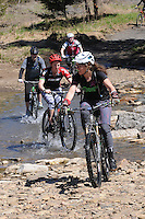 NWA Democrat-Gazette/FLIP PUTTHOFF <br /> Tandie Bailey leads riders across Lee Creek during a ride on the Fossil Flats Trail at Devil's Den State Park. The 5.5-mile route for hiking or mountain biking meanders through nature and history