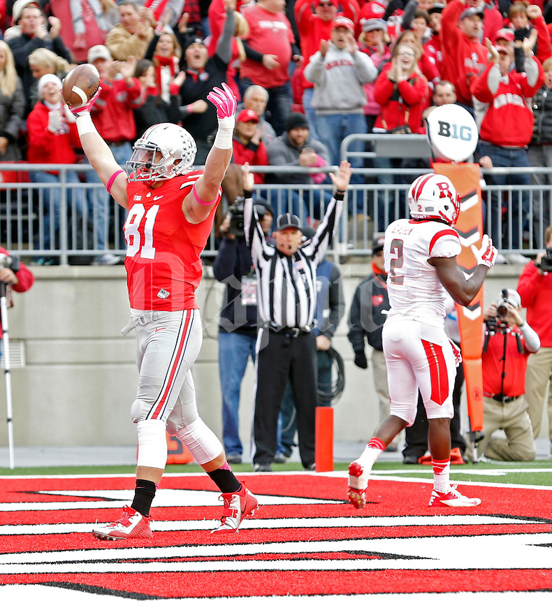 Ohio State Buckeyes tight end Nick Vannett (81) celebrates his touchdown catch against Rutgers Scarlet Knights defensive back Gareef Glashen (2) during the 1st quarter of their game at Ohio Stadium on October 18, 2014.   (Dispatch photo by Kyle Robertson)
