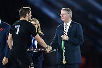 Richie McCaw of New Zealand shakes hands with Chairman of World Rugby Bernard Lapasset after the match. Rugby World Cup Final between New Zealand and Australia on October 31, 2015 at Twickenham Stadium in London, England. Photo by: Patrick Khachfe / Onside Images