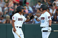 Jahmai Jones (19) of the Inland Empire 66ers greets teammate Michael Barash (32) after scoring during a game against against the Rancho Cucamonga Quakes at San Manuel Stadium on July 29, 2017 in San Bernardino, California. Inland Empire defeated Rancho Cucamonga, 6-4. (Larry Goren/Four Seam Images)