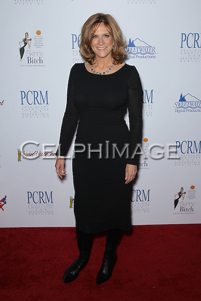 CAROL LEIFER. Red Carpet arrivals to The Art of Compassion PCRM 25th Anniversary Gala at The Lot in West Hollywood. West Hollywood, CA, USA. April 10, 2010.
