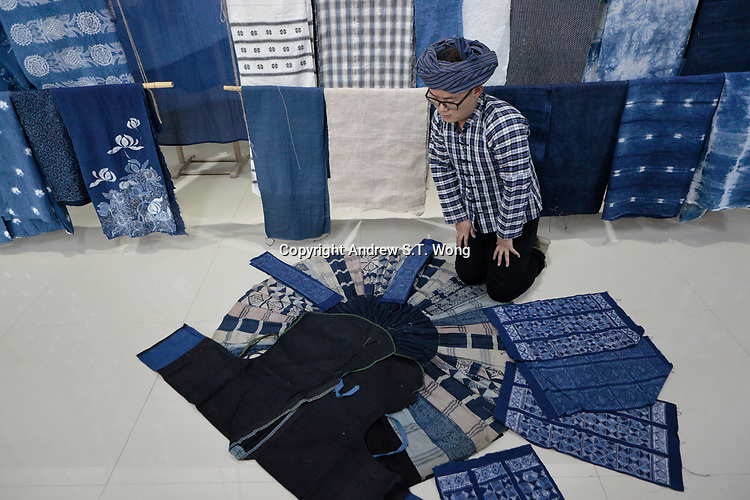 Ethnic Bouyei fashion designer Wei Xianglong works at his studio in Duyu, Guizhou Province, 2018.