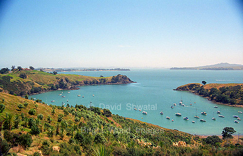 Water boats and hills of Matiatia Bay on scenic Whaiheke Island in Hauraki Gulf near Auckland New Zealand