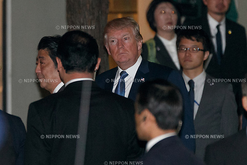 Japan's Prime Minister Shinzo Abe (L) and US President Donald Trump (C) arrive the Ukai-tei restaurant in Ginza on November 5, 2017, Tokyo, Japan. Trump and Abe enjoyed dinner in Tokyo after playing golf in the afternoon. Japan is the first stop on his five-nation tour in Asia. (Photo by Rodrigo Reyes Marin/AFLO)