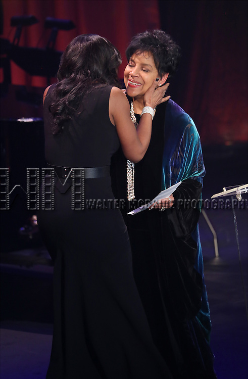 Audra McDonald and Phylicia Rashad onstage during the Roundabout Theatre Company's  50th Anniversary Gala at The Waldorf-Astoria on February 29, 2016 in New York City.