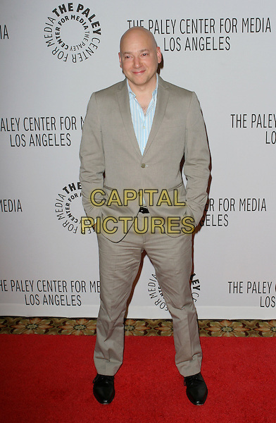 EVAN HANDLER .Arrives  at the Paley Center for Media annual gala, Century City, California, USA, 11th December 2008.full length suit jacket grey gray brown hands in pockets .CAP/ADM/TC.©T. Conrad//Admedia/Capital Pictures