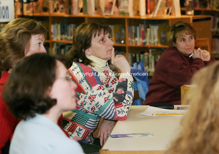 MIDDLEBURY, CT. 20 MARCH 2006- 032006BZ13- Virginia Emerick (CQ), of Southbury, who has 2 children- 1 attends Memorial Middle School- and other concerned patrents listen to a discussion with parents about Internet safety from Middlebury Police officer and Memorial Middle School (MMS) resource officer Ed Demers, Sharon Petti, library media specialist at MMS, and John Morris, technology coordinator for MMS, at the school Monday night.<br /> Jamison C. Bazinet Republican-American