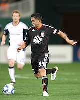 Jaime Moreno #99 of D.C. United moves away from Pat Phelan #28 of the New England Revolution during an MLS match on April 3 2010, at RFK Stadium in Washington D.C.