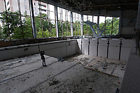 In the swimming hall &quot;Azure&quot; in Pripyat.<br /> Pripyat was built 1970 as a modern city for personnel at the Chernobyl Nuclear Power Plant, located some kilometers south. After the nuclear disaster at reactor 4 on April 26 1986, the town's 48.000 inhabitants was evacuated to other parts of the country. Pripiat is today a radioactive ghost town. The whole area is contamined with nuclear material, the half-life of plutonium-239 is more than 24.000 years.<br /> Pripyat, Ukraine.<br /> August 2008.