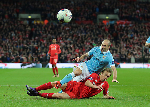 28.02.2016. Wembley Stadium, London, England. Capital One Cup Final. Manchester City versus Liverpool. Manchester City Defender Pablo Zabaleta is brought down by Liverpool Midfielder Lucas Leiva
