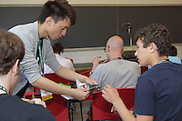 OrigamiUSA 2016 Convention at St. John's University, Queens, New York, USA. Kade Chan's teaches his origami design Capricorn to a morning class.