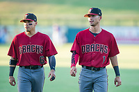 AZL Diamondbacks Jancarlos Cintron (6) and Walter Higuera (1) warm up in the outfield prior to the game against the AZL Cubs on August 11, 2017 at Sloan Park in Mesa, Arizona. AZL Cubs defeated the AZL Diamondbacks 7-3. (Zachary Lucy/Four Seam Images)