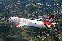 aerial photograph of N628VA, Virgin America Airlines Airbus A320-214, California flying along the San Mateo, California shoreline