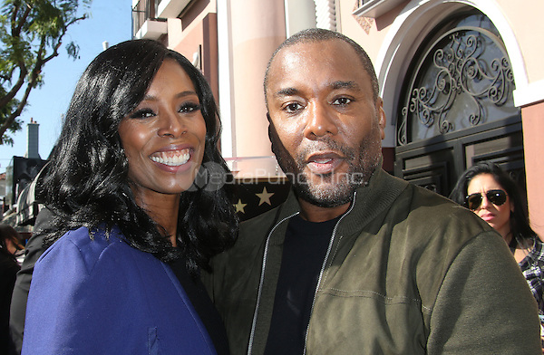"""Hollywood, CA - DECEMBER 02: Tasha Smith, Lee Daniels, At Lee Daniels Honored With Star On The Hollywood Walk Of Fame"""" At Pacific Theatres at the Hollywood Walk Of Fame, California on December 02, 2016. Credit: Faye Sadou/MediaPunch"""
