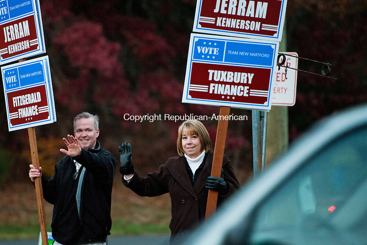 NEW HARFORD, CT - 5 November 2013-110513EC02--    New Hartford First Selectman Daniel Jerram and Selectman Alesia Kennerson wave at passing cars in New Hartford on election day near the fire house off of Route 202. Jerram, a republican, faces Democrat Troy LaMere and petioning candidate Dennis Minor. Erin Covey Republican American.