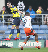 Blackpool's Viv Solomon-Otabor in action with Oxford United's Canice Carroll<br /> <br /> Photographer Mick Walker/CameraSport<br /> <br /> The EFL Sky Bet League One - Rochdale v Blackpool - Monday 1st January 2018 - Spotland Stadium - Rochdale<br /> <br /> World Copyright &copy; 2018 CameraSport. All rights reserved. 43 Linden Ave. Countesthorpe. Leicester. England. LE8 5PG - Tel: +44 (0) 116 277 4147 - admin@camerasport.com - www.camerasport.com