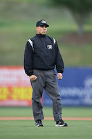 Umpire David Martinez handles the calls on the bases during the South Atlantic League game between the Hagerstown Suns and the Kannapolis Intimidators at Kannapolis Intimidators Stadium on May 5, 2016 in Kannapolis, North Carolina.  The Suns defeated the Intimidators 7-0.  (Brian Westerholt/Four Seam Images)