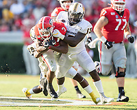 ATHENS, GA - SEPTEMBER 7: Zamir White #3 makes a run with Murray State's Don Parker #48 attempting to stop him with the help of Alec Long #13 during a game between Murray State Racers and University of Georgia Bulldogs at Sanford Stadium on September 7, 2019 in Athens, Georgia.