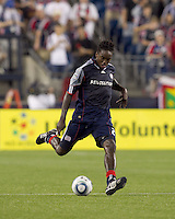 New England Revolution midfielder Shalrie Joseph (21) passes the ball. The New England Revolution defeated the Seattle Sounders FC, 3-1, at Gillette Stadium on September 4, 2010.
