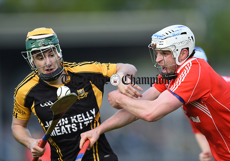 David Egan of Ballyea in action against Jason Greene of Crusheen during their quarter final in Cusack Park. Photograph by John Kelly.