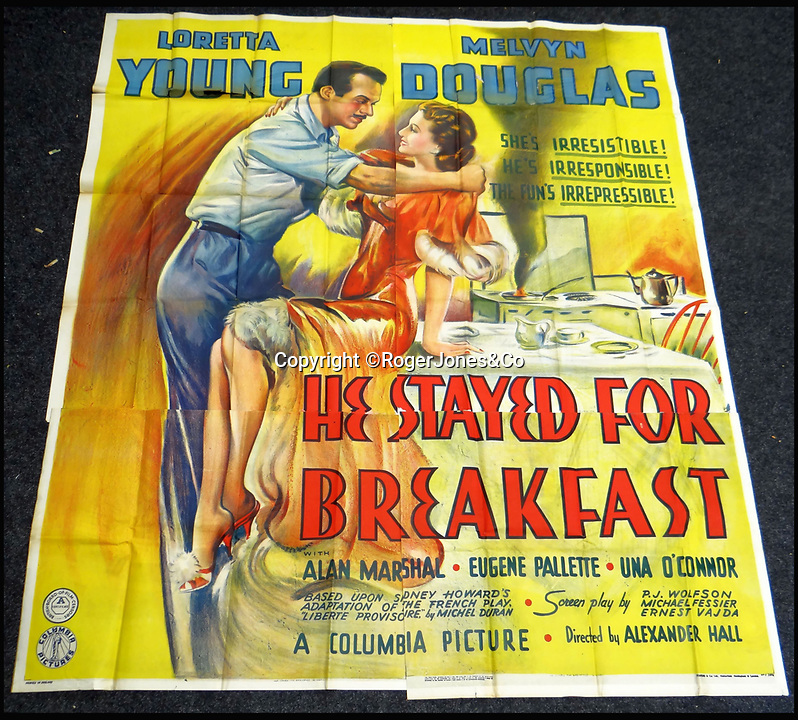 BNPS.co.uk (01202 558833)<br /> Pic: RogerJones&Co/BNPS<br /> <br /> He Stayed for Breakfast, 1940.<br /> <br /> A rare collection of 1930s and 40s cinema posters discovered by two builders after they were used as carpet underlay have sold for a whopping £75,000.<br /> <br /> More than half the total was made on a single poster, John Wayne's breakthrough film Stagecoach (1939), which sold for £31,000.<br /> <br /> The classic Hollywood movie posters, which were in near pristine condition, are from the halcyon days of cinema and included well known names such as Alfred Hitchcock, Sir Laurence Olivie and Boris Karloff.<br /> <br /> Before the sale auctioneers Rogers Jones & Co said it was difficult to predict what the posters would sell for as no comparisons had ever come to market but the collection of about 120 posters was expected to fetch several thousands.<br /> <br /> Two builders made the discovery in 1985 when they were renovating the home of a local cinema owner who had died in Penarth, south Wales.