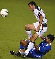 Landon Donovan avoids a tackle in San Salvador, El Salvador, Saturday Oct. 9, 2004. USA won 2-0.