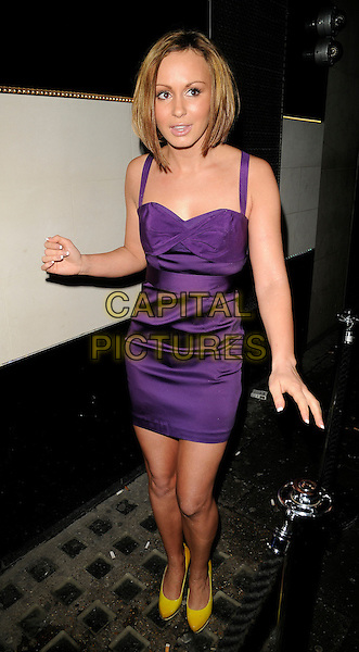 CHANELLE HAYES .The Neon Management weekly club night launch party, Vendome bat & nightclub, Piccadilly, London, England..January 28th, 2009.full length big brother purple silk satin dress yellow shoes.CAP/CAN.©Can Nguyen/Capital Pictures.