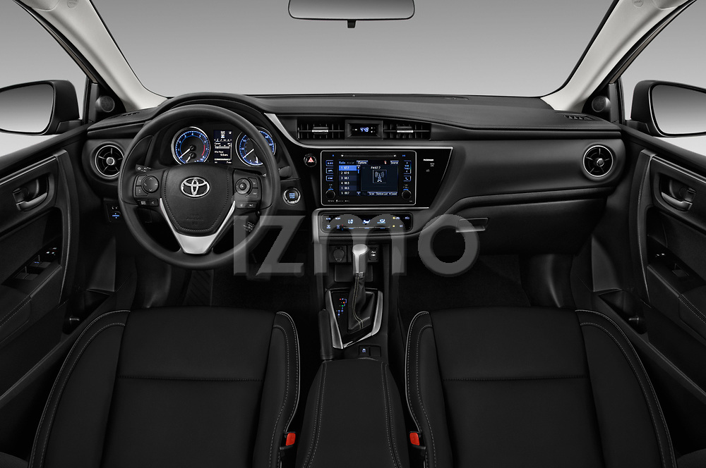 Stock photo of straight dashboard view of 2017 Toyota Corolla XLE Premium 4 Door Sedan