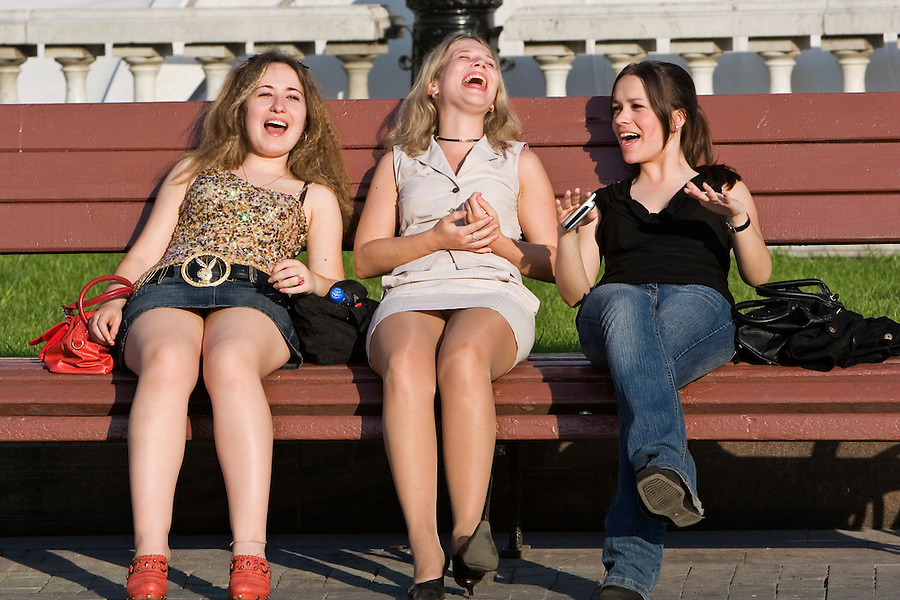 Moscow, Russia, 19/05/2007..Girls singing on a park bench on Manezh Square by the Kremlin during a heatwave.